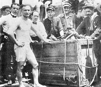 Harry houdini getting ready for buried alive trick