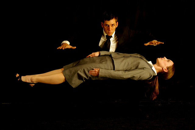 a magician levitating his assistant